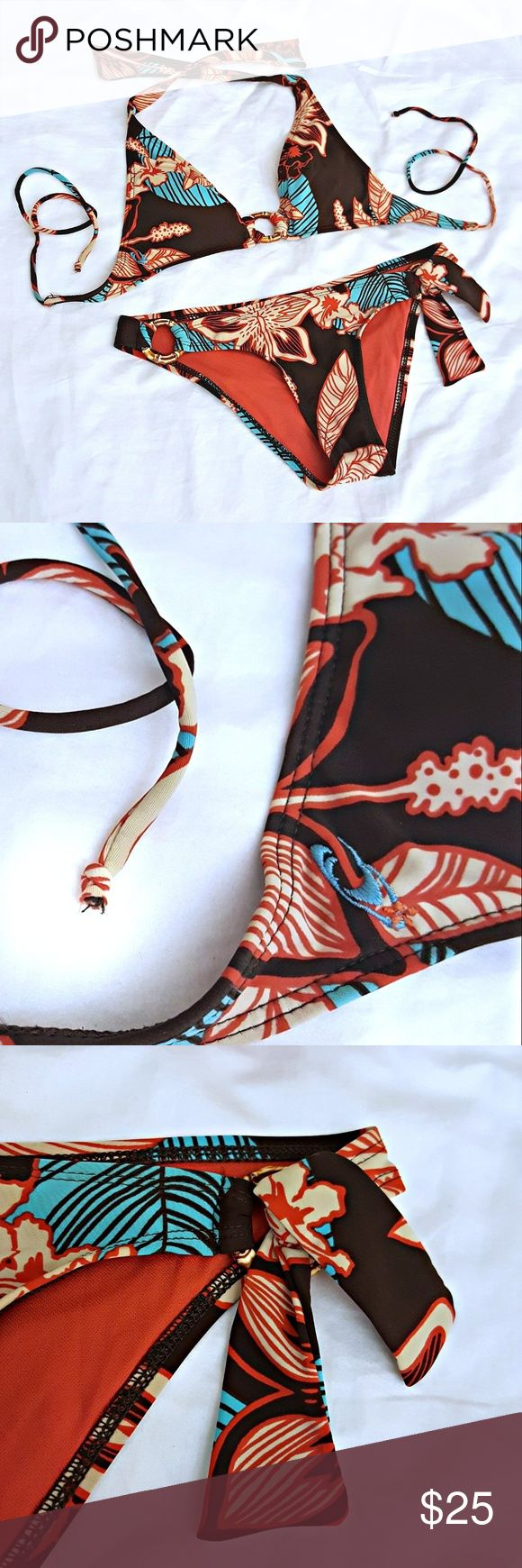 O'neill Bikini Two-Piece Suit O'neill String Bikini Two-Piece Suit. Dark chocolate brown bikini with Hawaiian floral print details in dark coral, aqua & khaki tan. Accented with faux bamboo rings. Aqua embroidered logo on both the top and  bottoms. Size tag was cut out. Very clean. Small hole in interior lining layer does not affect the outside of the suit. Otherwise EUC! O'Neill Swim Bikinis
