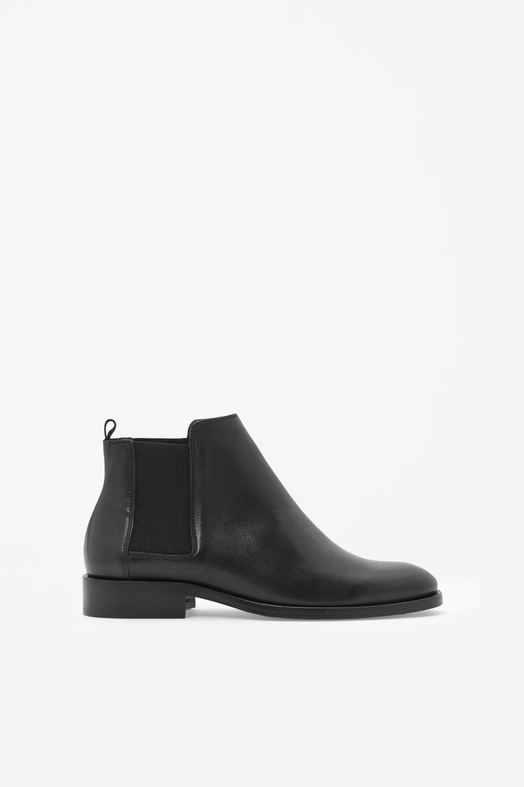 Our version of a classic style, these chelsea boots are made from smooth moulded leather with a contrast elastic panel on each side. Round-toed, they have a pull tab on the ankle and a stacked leather heel and sole.