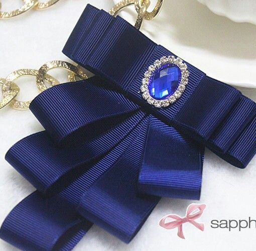 Ribbon bow with cabochon jewel