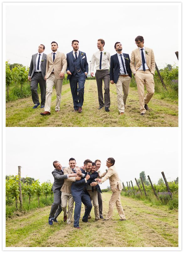 groomsmen with missed matched suit colors, but with uniform shirt and tie.