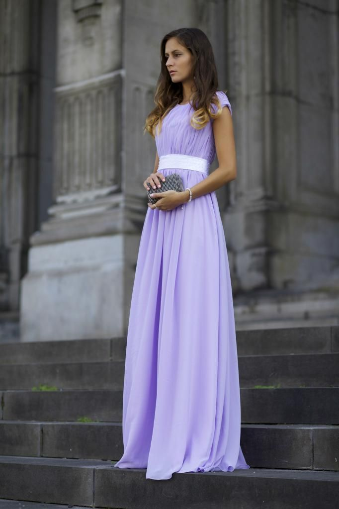 Shop this look on Lookastic:  http://lookastic.com/women/looks/light-violet-evening-dress-charcoal-embellished-clutch/10617  — Light Violet Evening Dress  — Charcoal Embellished Clutch