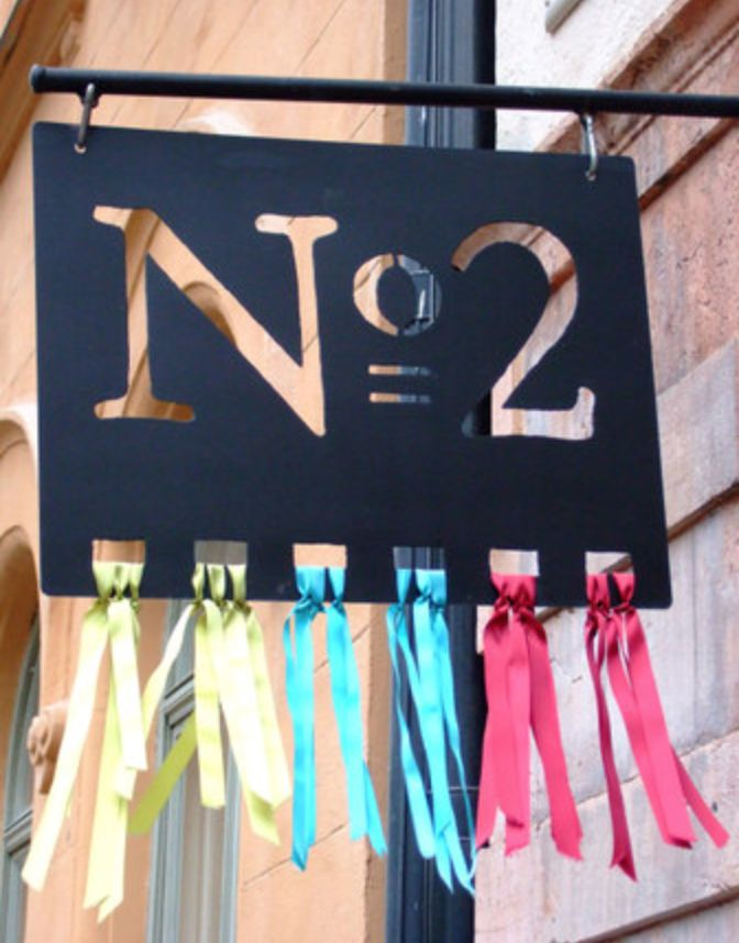 Exterior store signage / metal with ribbon detail