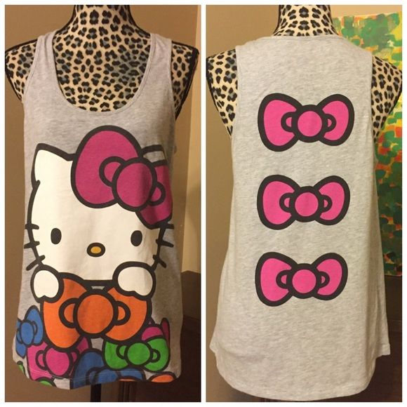 "Hello Kitty Bow Back Tank by Mighty Fine -- Medium Hello Kitty Bow Back Tank by Mighty Fine -- Medium --- 60% cotton 40% polyester ---  26"" length --- 19"" bust --- good used condition --- no imperfections  --- thank you for visiting my boutique, please feel free to ask any questions Mighty Fine Tops Tank Tops"