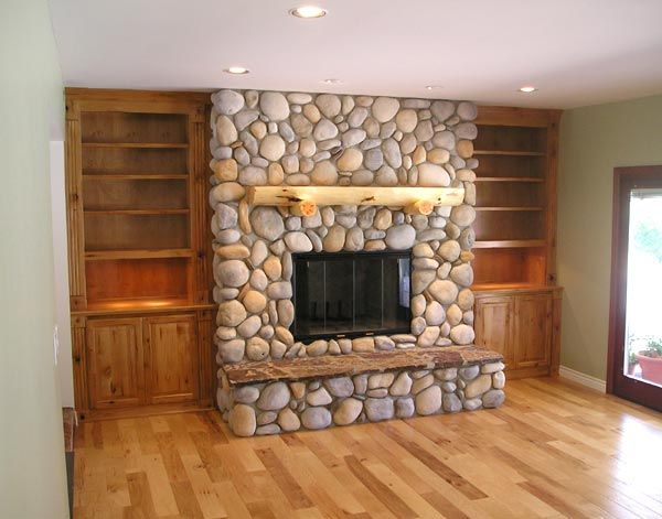 Working with the river rock... paint the built-in's grey? Love this with the book shelves!!!