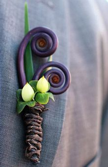 This unique boutonniere features fiddlehead ferns and hypericum berries; barked floral wire was used to wrap the stems. Flowers by Modern Day Floral