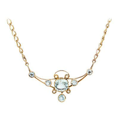 COLLIER  Gold. 9 K.  Executive with five Aquamarine 3.5 to 3.7 mm. Four pearls. Early 1900s.  Total weight: 9.7 g.  LENGTH 50 CM