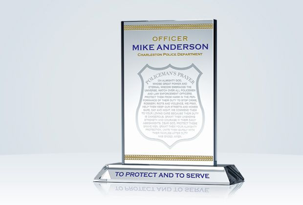 The Police Officer's Prayer Plaque with its sharp cut and sturdy base is the perfect combination of grace and strength. The words of the Policeman's Prayer engraved inside the shield are gentle and kind. The police motto engraved on the base and gold leaf border are permanent and unyielding.