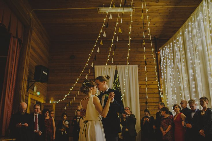 First dance under white led light series and pennants.