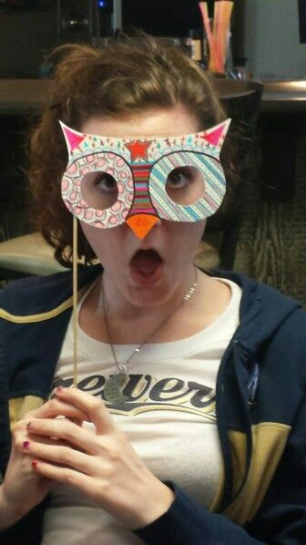 Here is one of my friends making a perfect bird face behind her owl mask! Owl party games and decorations were a smash hit!