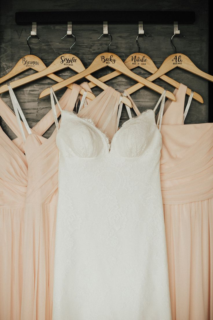 Taliah Leigh Photography • http://taliahleigh.com  #laceweddingdress #pinkbridesmaiddresses #weddinghangers #2017wedding