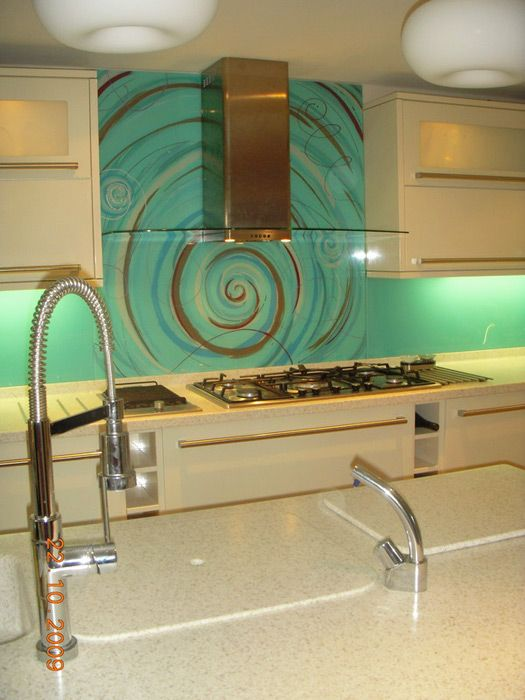 Blue and Brown patterned glass splashback in kitchen Via http://kitchenremodeldesigns.blogspot.com/2010/11/funky-kitchen-splashbacks.html
