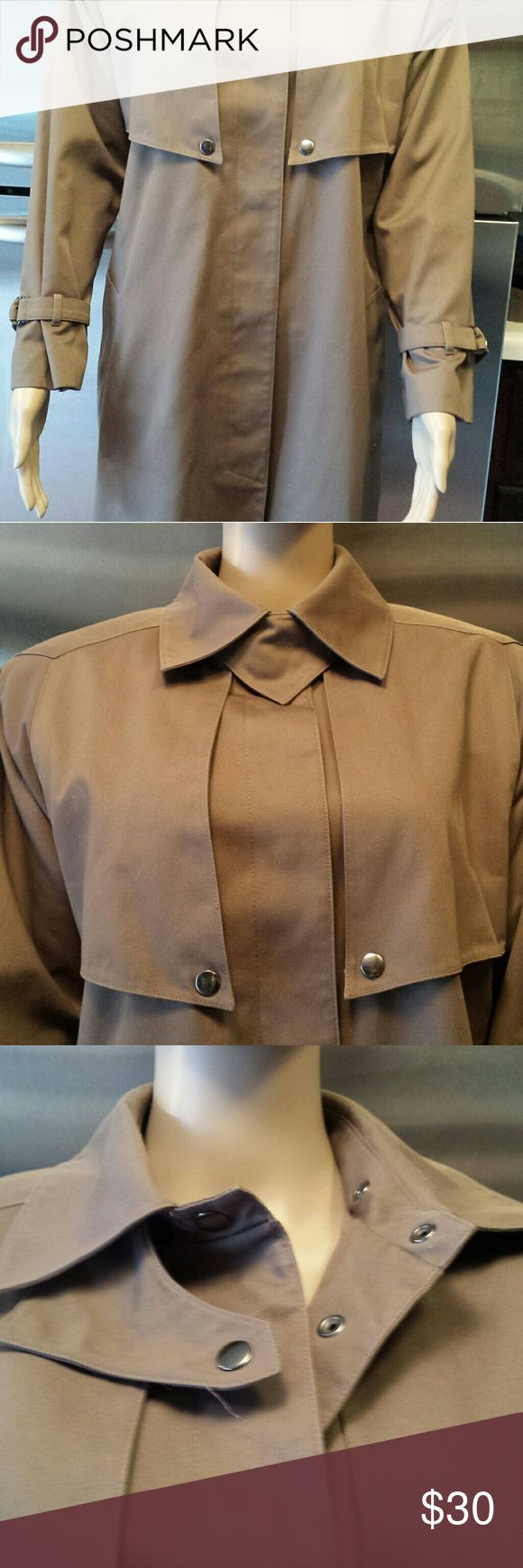 """Women's Bromley Trench / Rain Coat Petite Size 4 Bromley  Trench Coat w/ Lining. Med Brown . Size Petite 4. Top of neck to bottom of coat is 44"""" . Has 6 snaps down the  front. Comes with a belt but no loops. Two pockets. Had a take out lining. No stains or tears. Excellent Condition Bromley Jackets & Coats Trench Coats"""