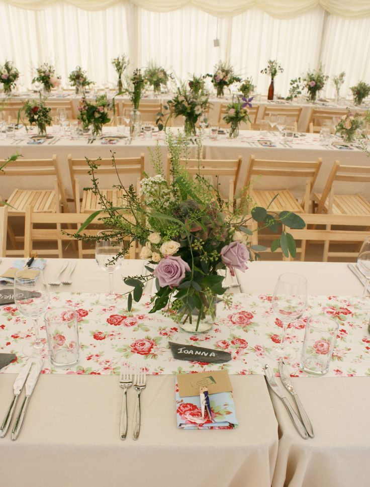 lovely country style flower display, marquee & fittings installed by www.24carrotevents.co.uk