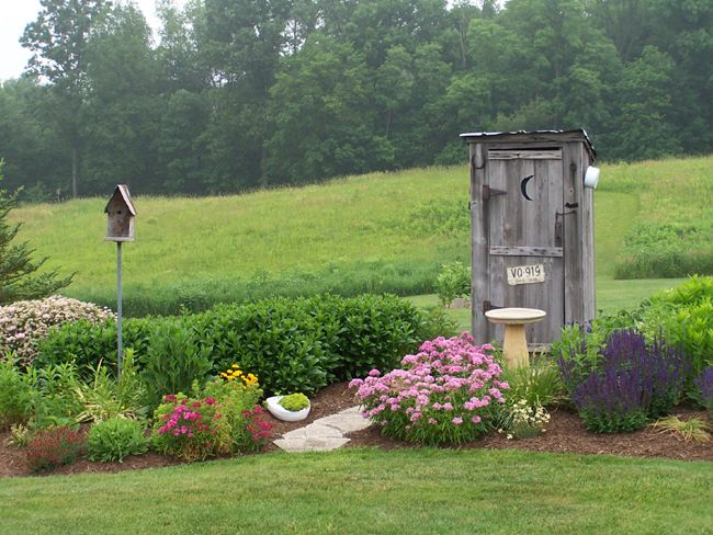 Outhouse Garden - I would love one of these for rakes and shovels.