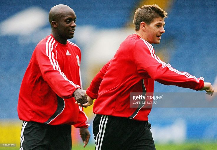 Liverpool's Mohamed Sissoko (L) and Steven Gerrard (R) hold hands during a training session on the eve of their Champions League Semi Final Football match against Chelsea, 24 April 2007 in London. Chelsea will play Liverpool at home for the first leg of their Semi Final match, at Stamford Bridge 25 April 2007.