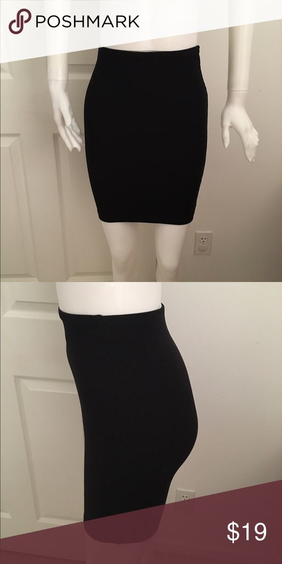 """American Apparel black ribbed tube mini skirt XS American Apparel black ribbed tube mini skirt XS. Elastic Waist measures 11"""" lying flat unstretched. Sideseam measures 19.5"""".  Made of nylon and elastane. Comes from a smoke free home. American Apparel Skirts Mini"""