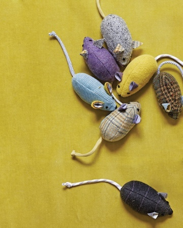 Menswear Mouse Toy    Treat a kitty to a game of cat and mouse with a few dapper toys. There's no mistaking these critters for the real thing -- they're constructed from brightly colored menswear fabrics.