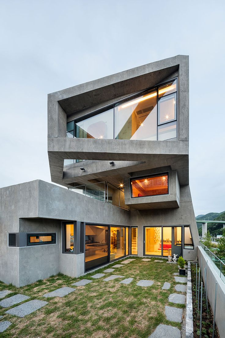 moon hoon's angular concrete dwelling in korea resembles a glaring owl