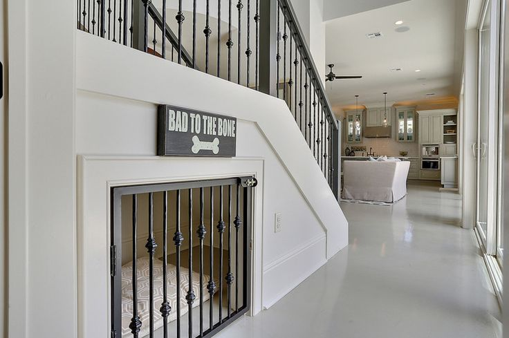 What a great idea! Transform an under-stair enclosure for your doggie(s)!! It's so much more attractive than a crate. Note matching stair rail spindles.
