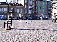 Memorial to victims of the Krakow ghetto in the form of oversized bronze chairs on the Plac Bohaterow Getta