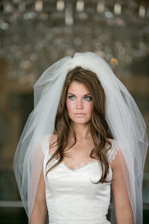 Gorgeous, full veil elbow-length veil is made of a single piece of soft ivory tulle, folded over to form a bubble veil. Hits at about elbow length on the sides with the lowest point at nearly fingerti                                                                                                                                                                                 More