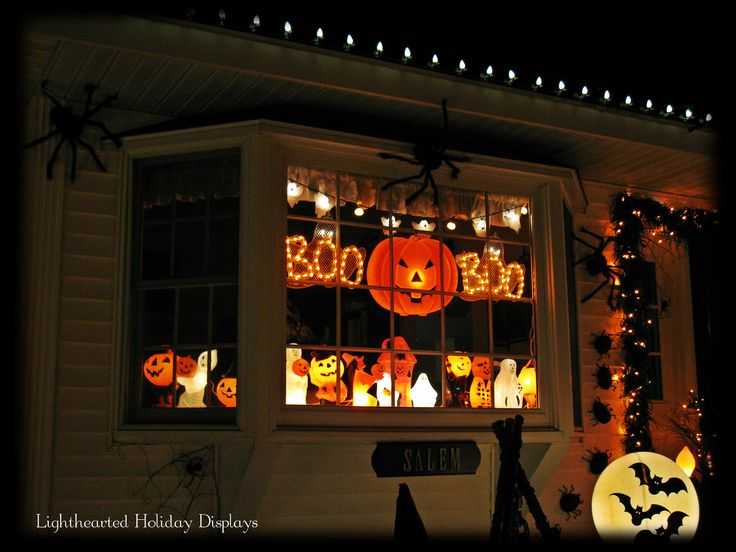 displaying some small halloween vintage blowmolds in front bay window - Halloween Window Decor