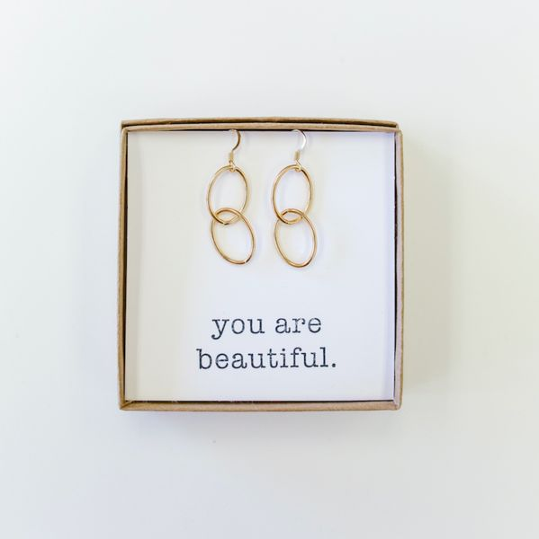 Our gold love chain earrings are a perfect match to our love chain necklace as part of the Touch the Sky Collection. Featuring 14K gold plated ear hooks and a personalized compliment in the box that can be customized at checkout.