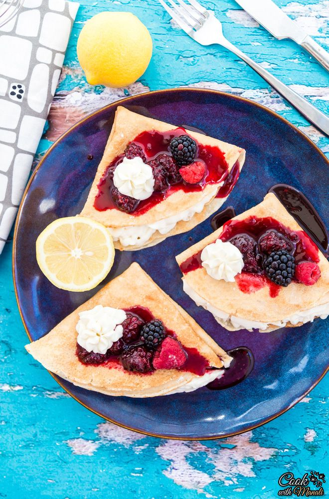 Lemon Crepes filled with Lemon Whipped Cream Cheese Filling and topped with Blackberry Sauce is a decadent brunch recipe to whip up this Mother's Day! #brunch #mothersday
