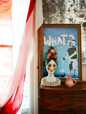 A vintage Italian ceramic vase sits in front of a Banksy print that Jenny bought in London. Photo: Armelle Habib