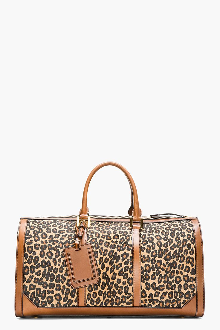 Structured calf-hair duffle bag in tan with leopard print in brown and black. Bridle leather trimmings throughout in tan. Gold tone hardware. Twin rolled leather carry handles at top. http://www.zocko.com/z/JJ6SJ