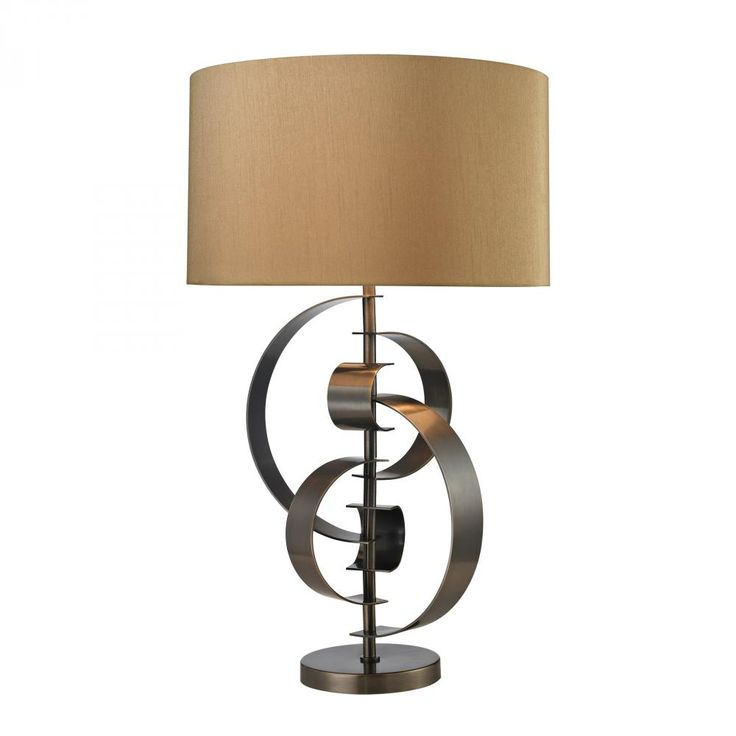"""The edgy and abstract features of the Volterra table lamp will revamp a drab living room, instantly! This massive 30"""" tall Diamond fixture is offered in Dun-brook finish."""
