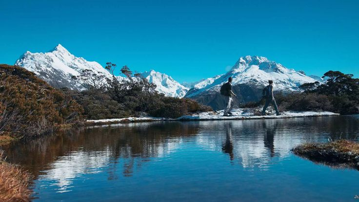 Routeburn Track.  At Key Summit, the peaks of Mount Aspiring National Park surround an alpine meadow dotted with lakes