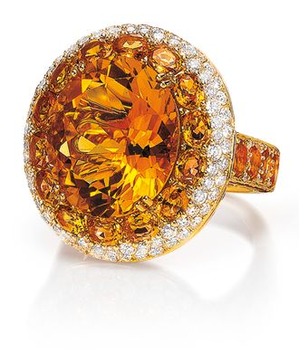 Citrine, Red Sapphire and Diamond Ring  Oval citrine surrounded with citrines, with red sapphires (not visible in picture) along the edge of the citrine shank and bezel, with diamond pavé; in 18-karat yellow gold.