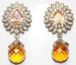 Hand-crafted brass metal cocktail danglers finely studded with cubic zirconia (American diamond) stones.  Size: 42mm X 18mm