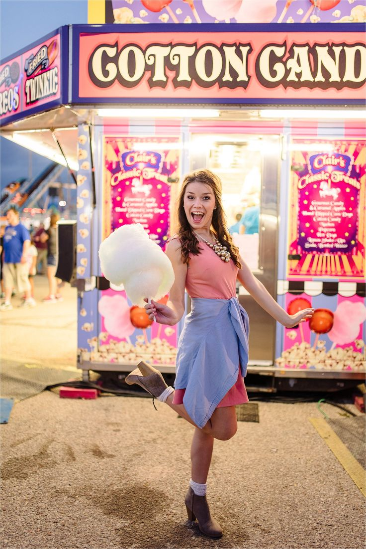 Wichita, KS senior portrait session at the state fair by KyAnn Raye Photography. Cotton candy, pink session ideas. Carnival senior session. Class of 2017. Gorgeous, senior girl portrait. Fun, unique senior session! Wichita, KS senior photographer. Cute senior, fair and carnival session posing ideas!