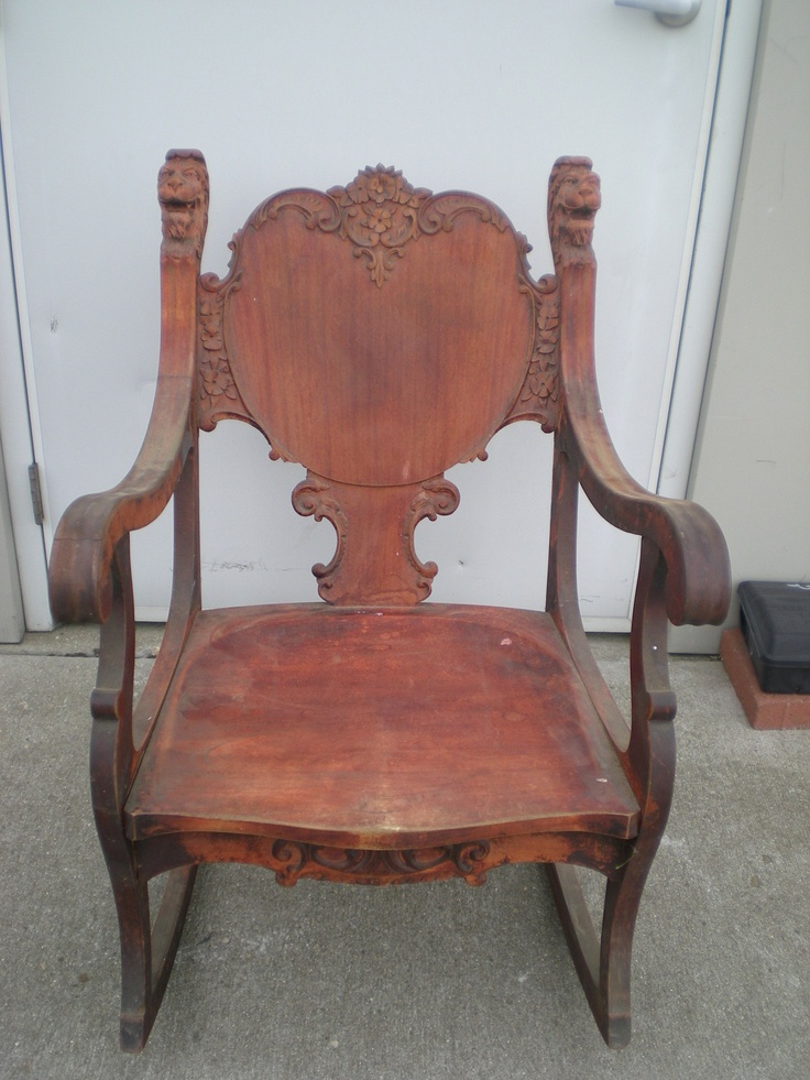 swivel rocking chair parts black outdoor antique with carved face   furniture