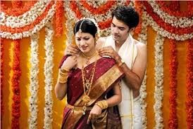In Indian weddings, the Mangala Sutra is tied around the bride's neck instead of exchanging rings. The mangala sutra is a cord with two gold pendants and is tied in three knots by the groom to symbolize the bonding of the two souls for 100 years. This necklace lets others know that the bride is married.