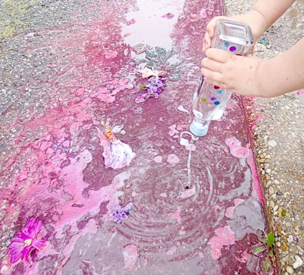 Rainy day activities: add vinegar and baking soda to makes fizzy puddles