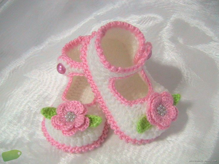 cute baby slipper with pink flowers.