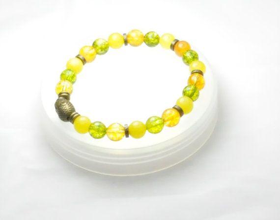 Peridot, yellow Jader and amber gemstone bracelet with Tibetan bronze Buddha head.