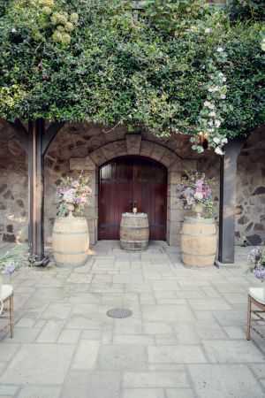 Winery ceremony with wine barrel accents