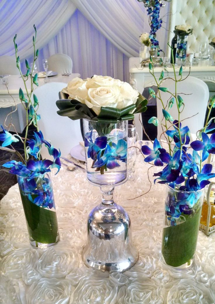 Blue dendrobium orchid with roses headtable detail