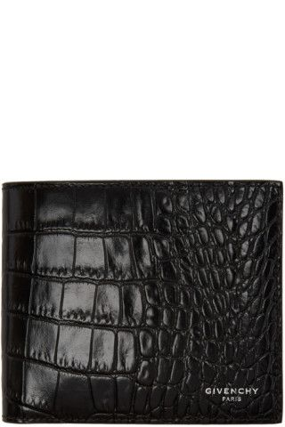 Croc-embossed leather bifold wallet in black. Logo stamp in silver-tone at face. Embossed logo, card slots, and note slots at interior. Buffed leather and textile lining in black. Tonal stitching. Approx. 4.5 length x 3.75 height.