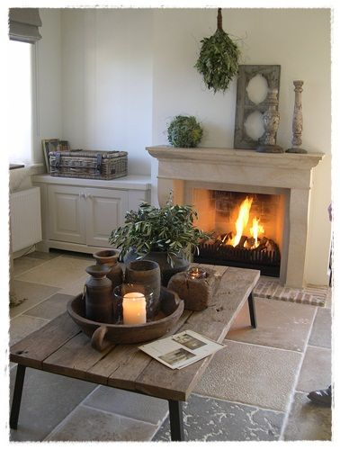 lovely fireplace...loving the floors and all the earthenware