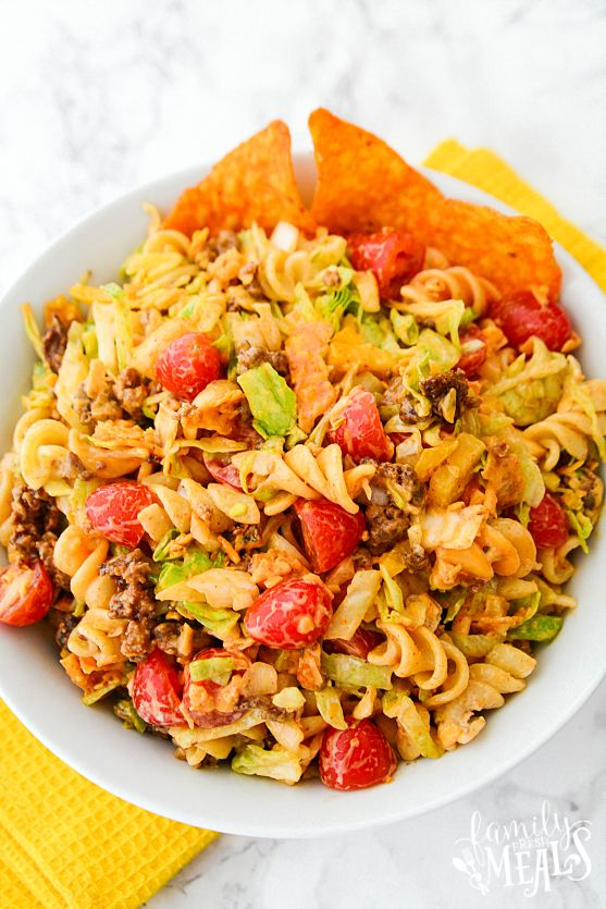 This Easy Taco Pasta Salad has all the features of a great taco salad – seasoned ground beef, lettuce, tomatoes, cheese, sour cream, and crushed corn chips.
