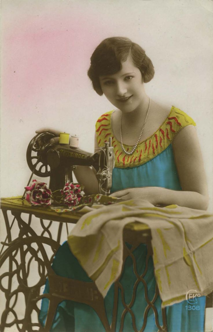 Vintage sewing postcard - lovely lady posing with Singer sewing machine (postmarked 1928).