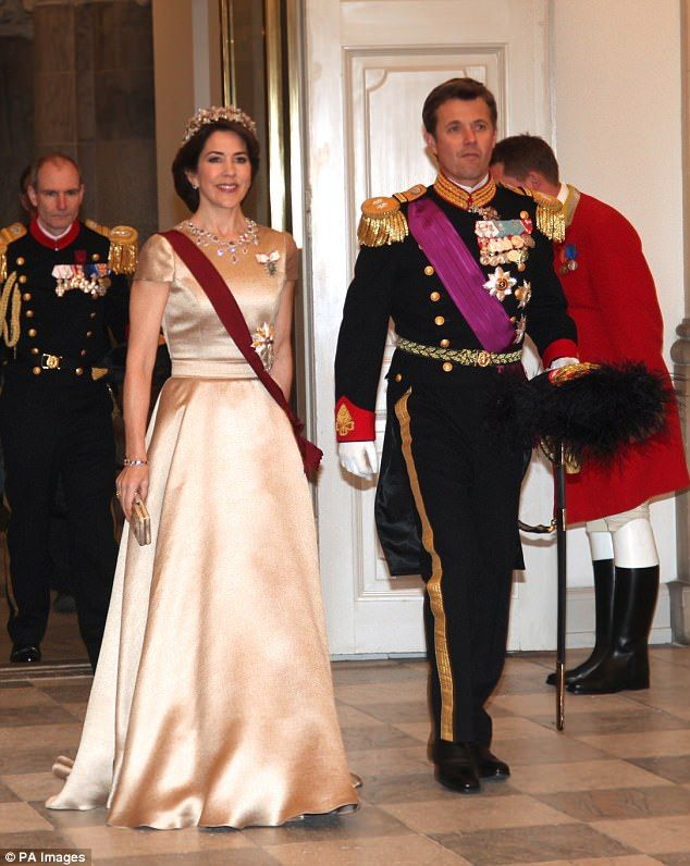 Glamorous in gold: After a day of exclusive sightseeing, the Danish royal family (pictured...