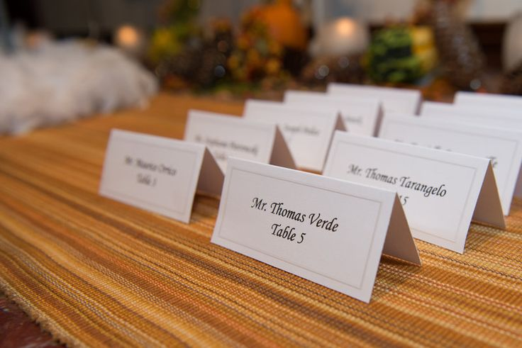 Orange accent on escort card table for wedding  Photo By Sherry Sutton Photography