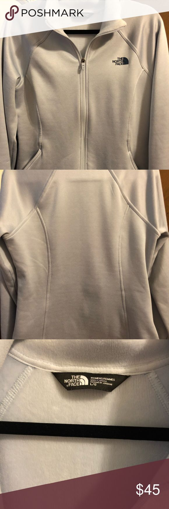 """Warm North Face Ladies' jacket -lovely jacket from The North Face -women's size L, grayish-blueish in color -warm and fuzzy on the inside 🤗 -smoke-free home -zip pockets -one small pick on the back side of sleeve {as shown in pic} -measures 21"""" across front underneath arms, zipped -measures 18"""" across front at waist, zipped  -measures 26"""" in length from shoulder to bottom The North Face Jackets & Coats"""