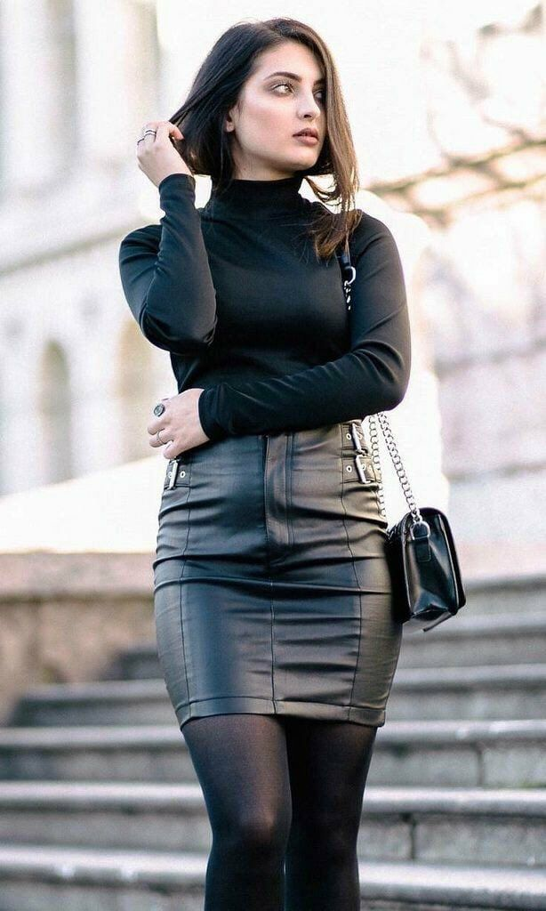 Black turtleneck and leather skirt outfit